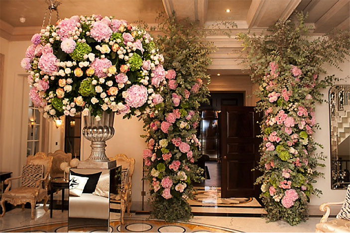 Pink wedding flowers over entrance