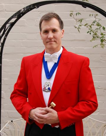 Find Toastmasters - The Man in the Red Coat