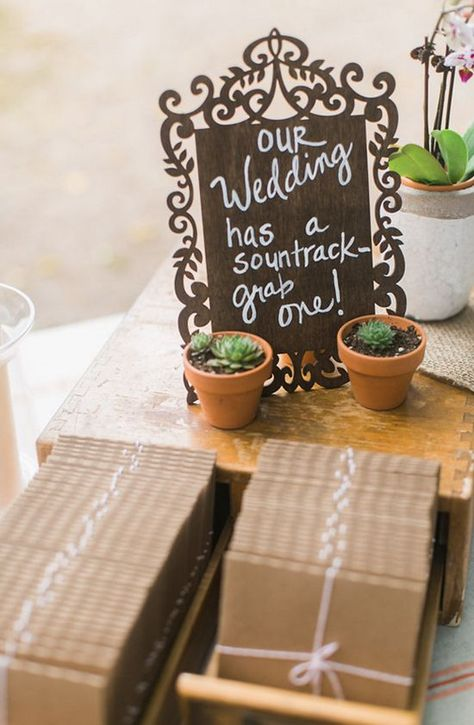 4. Make the bride and groom's chairs stand out by decking them out with goregous foliage and calligraphy signs. These will also make for fab photos on the night. 